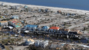 In this Oct. 12, 2018 file photo, devastation from Hurricane Michael is seen in this areal photo over Mexico Beach, Fla. The tropical weather that turned into monster Hurricane Michael began as a relatively humble storm before rapidly blossoming into the most powerful cyclone ever to hit the Florida Panhandle, causing wrenching scenes of widespread destruction.(AP Photo/Gerald Herbert)