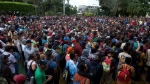 Thousands of Honduran migrants wait at the border between Guatemala and Mexico, in Tecun Uman, Guatemala, Friday, Oct. 19, 2018. Members of a 3,000-strong migrant caravan have massed in this Guatemalan border town across the muddy Suchiate River from Mexico, as U.S. President Donald Trump threatens retaliation if they continue toward the United States. (AP Photo/Moises Castillo)