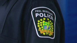 A badge on the uniform of a Peel Regional Police officer is seen in this undated file image.