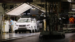 Line workers assemble a Lexus SUV at the Toyota plant in Cambridge, Ont., Friday, July 31, 2015. THE CANADIAN PRESS/Aaron Lynett