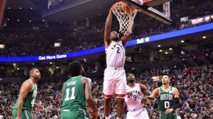 Toronto Raptors forward Kawhi Leonard (2) dunks on the Boston Celtics during second half NBA action in Toronto on Friday, October 19, 2018. THE CANADIAN PRESS/Frank Gunn