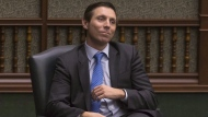 Former Ontario PC Leader Patrick Brown sits in his chair as an Independent MPP as he listens to Provincial Finance Minister Charles Sousa deliver the Ontario Provincial Government 2018 Budget , at the Queens Park Legislature in Toronto, on Wednesday March 28, 2018. Patrick Brown is down, but he may not be out yet. THE CANADIAN PRESS/Chris Young
