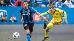 Montreal Impact's Daniel Lovitz, left, moves in on Columbus Crew SC's Pedro Santos during second half MLS soccer action in Montreal, Saturday, October 6, 2018. THE CANADIAN PRESS/Graham Hughes