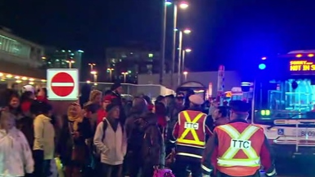 Passengers are seen outside Kennedy subway station after a fatal stabbing closed the station. (CP24)
