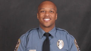 This undated photo provided by the Gwinnett County Police Department on Saturday, Oct. 20, 2018 shows Officer Antwan Toney. On Saturday, Toney was killed after being shot while responding to a suspicious vehicle parked near a middle school. (Gwinnett County Police Department via AP)