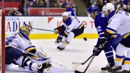 Toronto Maple Leafs centre Patrick Marleau (12) keeps his eye on the puck rebound as St. Louis Blues defenceman Alex Pietrangelo (27) tries to intercept during third period NHL action in Toronto on Saturday, Oct. 20, 2018. St. Louis Blues goalie Jake Allen (34) looks on. THE CANADIAN PRESS/Frank Gunn