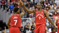 Toronto Raptors forward Serge Ibaka (9) gets a high five from guard Kyle Lowry (7) after he was fouled during the second half of an NBA basketball game against the Washington Wizards, Saturday, Oct. 20, 2018, in Washington. The Raptors won 117-113. (AP Photo/Nick Wass)