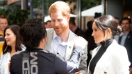 Meghan, Duchess of Sussex, watches her husband Britain's Prince Harry speaks during a lunchtime reception hosted by Australian Prime Minister Scott Morrison with Invictus Games competitors, their families and friends in Sydney Sunday, Oct. 21, 2018. (Paul Edwards/Pool Photo via AP)