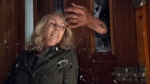 "This image released by Universal Pictures shows Jamie Lee Curtis in a scene from ""Halloween,"" in theaters nationwide on Oct. 19. (Ryan Green/Universal Pictures via AP)"