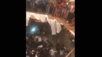 This frame from video shows a floor that collapsed during a party at an apartment near the campus of Clemson University early Sunday, Oct. 21, 2018, in Clemson, S.C. (Jeremy Tester via AP)