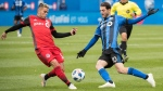 Montreal Impact's Ignacio Piatti (10) challenges Toronto FC's Ashtone Morgan during first half MLS soccer action in Montreal, Sunday, October 21, 2018. THE CANADIAN PRESS/Graham Hughes