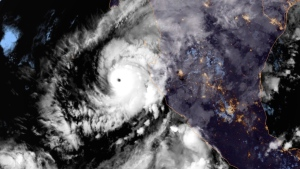 This image provided by NOAA on Monday, Oct. 22, 2018, shows Hurricane Willa in the eastern Pacific, on a path to smash into Mexico's western coast. (NOAA via AP)