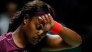 Sloane Stephens of the United States wipes her brows during a women's singles match against Naomi Osaka of Japan at the WTA tennis tournament in Singapore on Monday, Oct. 22, 2018. (AP Photo/Vincent Thian)