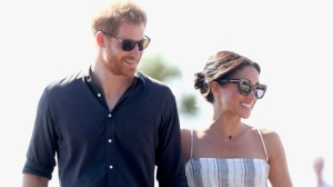 Prince Harry and Meghan, Duchess of Sussex walk along the Kingfisher Bay Jetty Monday, Oct. 22, 2018 in Fraser Island, Australia. The Duke and Duchess of Sussex took separate boats Monday to Queensland's Fraser Island as their tour of Australia and the South Pacific continued with a reduced schedule for the pregnant duchess.(Chris Jackson/Pool Photo via AP)
