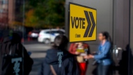 Voters line up outside a voting station to cast their ballot in the Toronto's municipal election in Toronto on Monday, October 22 , 2018. THE CANADIAN PRESS/Chris Young