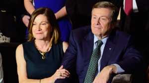 Toronto Mayor John Tory and wife Barbara Hackett watch a television as the polls close in the Ontario municipal election in Toronto, on Monday, October 22, 2018. THE CANADIAN PRESS/Frank Gunn