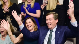 Toronto Mayor John Tory and wife Barbara Hackett along with other family and friends celebrate after being re-elected mayor in the Ontario municipal election in Toronto, on Monday, October 22, 2018. THE CANADIAN PRESS/Frank Gunn