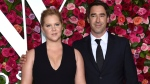FILE - In this June 10, 2018 file photo, Amy Schumer, left, and Chris Fischer arrive at the 72nd annual Tony Awards in New York. (Photo by Evan Agostini/Invision/AP, File)