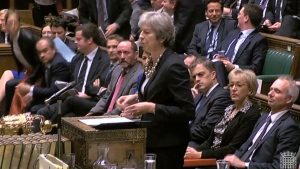 In this image taken from Parliament TV, Britain's Prime Minister Theresa May makes a statement to the House of Commons about the European Council summit, in London, Monday Oct. 22, 2018. May faces dissent from political opponents and from within her own ruling Conservative Party over her blueprint for the Brexit separation and future relations with the EU. (Parliament TV via AP)