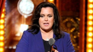 FILE - In this June 8, 2014, file photo, Rosie O'Donnell accepts the Isabelle Stevenson Award on stage at the 68th annual Tony Awards in New York. O'Donnell confirmed to People magazine on Monday, Oct. 22, 2018, her engagement to Elizabeth Rooney. (Photo by Evan Agostini/Invision/AP, File)
