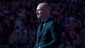 Former Toronto Maple Leafs captain Mats Sundin holds a puck as he stands on centre ice while being honoured ahead Toronto Maple Leafs and Boston Bruins NHL hockey action in Toronto on Saturday March 23, 2013. Mats Sundin isn't surprised the Toronto Maple Leafs are asking their young stars to make a financial sacrifice to stay together. THE CANADIAN PRESS/Chris Young
