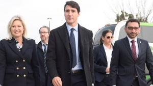 Prime Minister Justin Trudeau and Mississauga Mayor Bonnie Crombie arrive at the City Centre transit terminal in Mississauga, Ont., Tuesday, Oct.23, 2018. THE CANADIAN PRESS/Nathan Denette