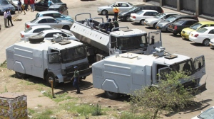 Zimbabwean Riot Police with water canons are seen parked in Harare, Thursday, Oct. 11, 2018. Lawyers say police in the country have arrested dozens of trade union members ahead of planned protest in the capital over the worst economic crisis in a decade. There is a heavy police presence in Harare after the government banned the protest, citing an ongoing cholera outbreak. (AP Photo/Tsvangirayi Mukwazhi)