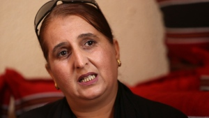 In this Monday, Oct. 22, 2018 photo, Taghreed Abu Teer, recalls being held by Hamas authorities for 11 days and interrogated under 'humiliating circumstances' for her activities with the rival Fatah movement during an interview with The Associated Press at a relative's home in Khan Younis, southern Gaza Strip.  (AP Photo/Adel Hana)