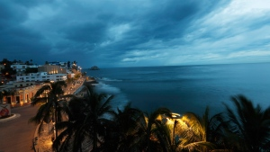 Clouds move in over Mazatlan, Mexico, Tuesday, Oct. 23, 2018, before the arrival of Hurricane Willa. Willa is headed toward a Tuesday afternoon collision with a stretch of Mexico's Pacific coast, its strong winds and high waves threatening high-rise resorts, surfing beaches and fishing villages. (AP Photo/Marco Ugarte)