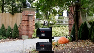 Mailboxes stand outside the entrance to a house owned by philanthropist George Soros in Katonah, N.Y., a suburb of New York City, Tuesday, Oct. 23, 2018.  (AP Photo/Seth Wenig)