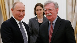 Russian President Vladimir Putin, left, and U.S. National security adviser John Bolton shakes hands during their meeting in the Kremlin in Moscow, Russia, Tuesday, Oct. 23, 2018. (AP Photo/Alexander Zemlianichenko)
