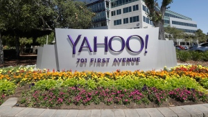 In this July 19, 2016, file photo, flowers bloom in front of a Yahoo sign at the company's headquarters in Sunnyvale, Calif.  (AP Photo/Marcio Jose Sanchez, File)