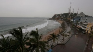 Rain begins to fall over Mazatlan before the arrival of Hurricane Willa, in Mazatlan, Mexico, Tuesday, Oct. 23, 2018. Emergency officials said they evacuated more than 4,250 people in coastal towns and set up 58 shelters ahead of the dangerous Category 3 storm, which was expected to blow ashore tonight. (AP Photo/Marco Ugarte)