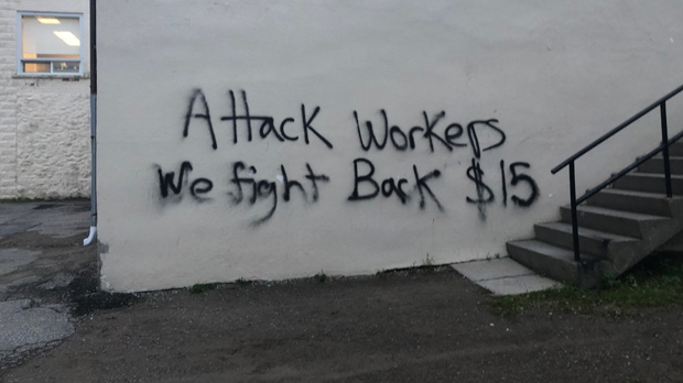 Graffiti is seen on the wall of Labour Minister Laurie Scott's constituency office in Lindsay, Ont. on Oct. 24, 2018. (Premier's Office)
