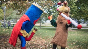 Two costumed figures, including Tokaroo, right, mark the first day of legalization of cannabis across Canada in a Toronto park on Wednesday, October 17, 2018. Mascot maker Mark Scott says he will not buckle to legal threats from Ontario's public broadcaster over his pothead parody of the beloved children's TV character Polkaroo. THE CANADIAN PRESS/Chris Young