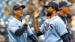 Tampa Bay Rays pitcher Alex Colome, right, is congratulated after a save by third base coach Charlie Montoyo following a baseball game against the Baltimore Orioles, Sunday, July 17, 2016, in St. Petersburg, Fla. The Rays won 5-2. (AP Photo/Reinhold Matay)
