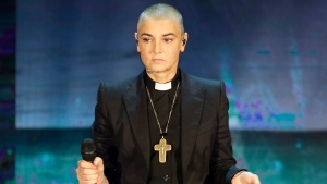 """In this Oct. 5, 2014 file photo, Irish singer Sinead O'Connor performs during the Italian State RAI TV program """"Che Tempo che Fa"""", in Milan, Italy. 51-year old O'Connor has announced Friday Oct. 26, 2018, that she has converted to Islam and said she has changed her name to Shuhada' Davitt.(AP Photo/Antonio Calanni, FILE)"""