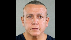 In this undated photo released by the Broward County Sheriff's office, 56-year-old Cesar Sayoc is seen in a booking photo, in Miami. (Broward County Sheriff's Office via AP)
