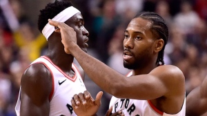 Toronto Raptors forward Kawhi Leonard (2) and teammate Pascal Siakam (43) celebrate their team's win following second half NBA basketball action against the Dallas Mavericks, in Toronto on Friday, Oct. 26, 2018. THE CANADIAN PRESS/Frank Gunn
