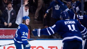 Toronto Maple Leafs right wing Kasperi Kapanen (24) reacts with teammates after scoring the game winning goal against the Winnipeg Jets during third period NHL hockey action in Toronto on Saturday, October 27, 2018. THE CANADIAN PRESS/Nathan Denette