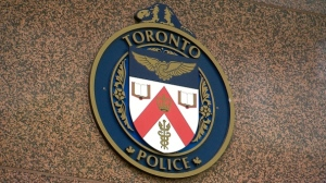 The logo for Toronto Police Service is seen.