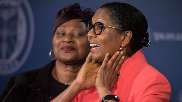 Lyneth Mann-Lewis, centre, of Brampton, Ont., is joined by family members while discussing her initial reaction to reuniting with her son Jermaine Mann, who until recently, was living under an alias in the U.S, during a press conference at Toronto Police Headquarters in Toronto on Monday, October 29, 2018. Her son was allegedly abducted by his father 31 years ago. THE CANADIAN PRESS/ Tijana Martin