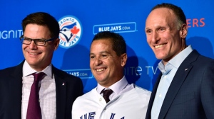 New Toronto Blue Jays manager Charlie Montoyo, centre, poses with Blue Jays General Manager Ross Atkins, left, and Blue Jays President Mark Shapiro at a news conference in Toronto on Monday, October 29, 2018. THE CANADIAN PRESS/Frank Gunn