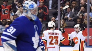 Calgary Flames centre Elias Lindholm (28) celebrates his goal with centre Sean Monahan (23) as Toronto Maple Leafs goaltender Frederik Andersen (31) looks on during third period NHL hockey action in Toronto on Monday, October 29, 2018. THE CANADIAN PRESS/Nathan Denette