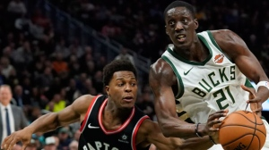 Milwaukee Bucks' Tony Snell tries to drive past Toronto Raptors' Kyle Lowry during the second half of an NBA basketball game Monday, Oct. 29, 2018, in Milwaukee. (AP Photo/Morry Gash)