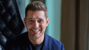 """In this Tuesday, Oct. 18, 2016 file photo,Canadian singer Michael Buble poses for a photo to promote the upcoming Oct. 21 release of his new album """"Nobody But Me"""" in Toronto (Michelle Siu/The Canadian Press via AP, File)"""