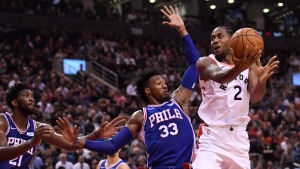Toronto Raptors forward Kawhi Leonard (2) is fouled by Philadelphia 76ers forward Robert Covington (33) as Philadelphia 76ers centre Joel Embiid (21) looks on during first half NBA basketball action in Toronto on Tuesday, October 30, 2018. THE CANADIAN PRESS/Nathan Denette