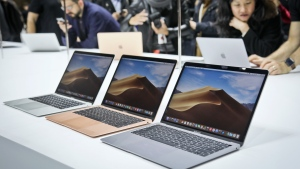 Apple's new MacBook Air computers on display during the company's showcase of new products Tuesday Oct. 30, 2018, in the Brooklyn borough of New York. (AP Photo/Bebeto Matthews)