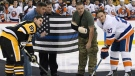 Pittsburgh Police Officer Mike Smidga, Pittsburgh Police Chief Scott Schubert and Officer Anthony Burke take part in a ceremonial puck drop with Pittsburgh Penguins center Sidney Crosby (87) and New York Islanders left wing Anders Lee (27) before an NHL hockey game in Pittsburgh, Tuesday, Oct. 30, 2018. The officers were wounded in a synagogue shooting on Oct. 27, 2018.(AP Photo/Don Wright)