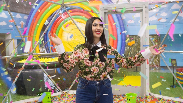 "Instagram influencer Negin Tavana, whose page @Negzila has more than 35,000 followers, is pictured in the confetti dome at the pop art installation ""Happy Place"" in Toronto, on Monday, October 29, 2018. THE CANADIAN PRESS/Chris Young"